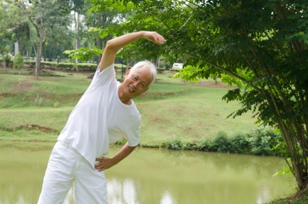 asian senior man workout in the park   photo