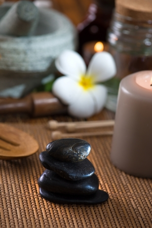 seething: hot stone massage with spa treatment items on the background