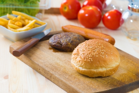 hamburger fast food ingredients with plenty of raw materials on the background photo