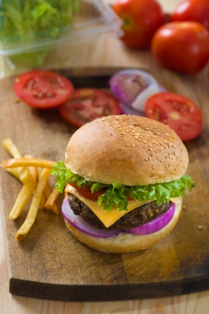 burger with fast food items and materials on the background photo