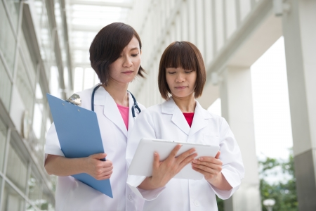 asian chinese female doctors team at the hospital photo