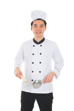 asian male chef with isolated white background photo