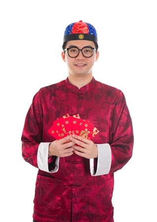 gong xi fa cai: chinese new year male wishing gong xi fa cai isolated in white background Stock Photo