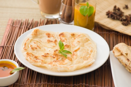usually: roti canai flat bread, very famous mamak food in malaysia, usually served wtih curry sambal or sugar   Stock Photo