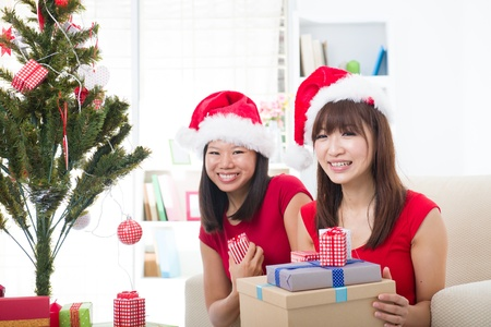 chinese girl friends during a christmas celebration   photo