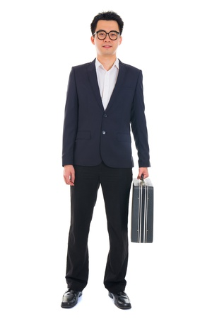 chinese asian young business man with suitcase isolated on white background photo