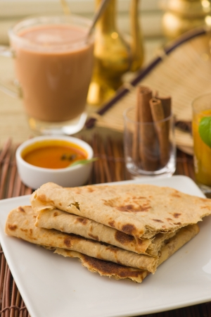 ramzan:  chapati Paratha Fold with traditional indian items background