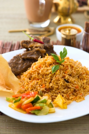 mutton: Mutton Biryani rice with traditional items on background