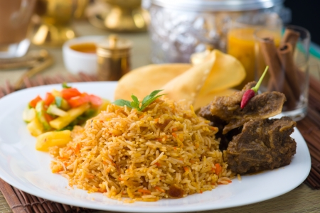 biryani: Biryani basmati mutton rice with traditional items on background Stock Photo