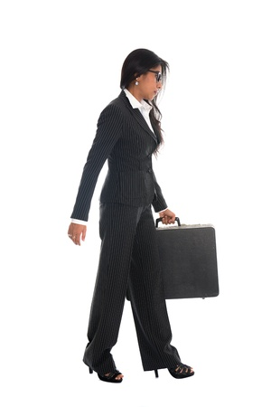asian indian business woman full length walking with a suitcase isolated in white background photo