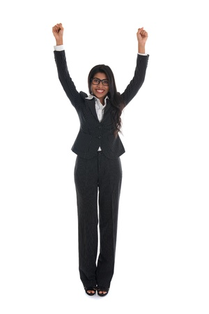 asian indian business woman celebrating success with black suit isolated on white   photo