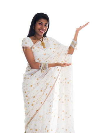indian saree: traditional indian female woman with welcome sign and isolated white background Stock Photo