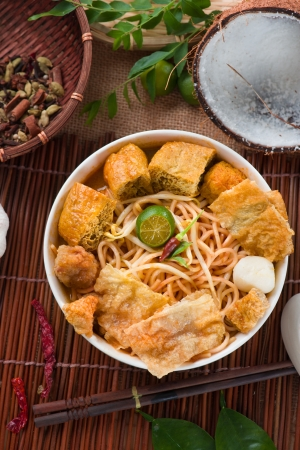 laksa: asam laksa noodle ,Penang style with raw ingredients on background