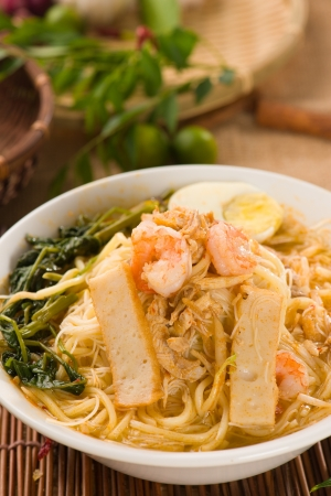 malaysian famous prawn noodle or har mee with decorations on background photo