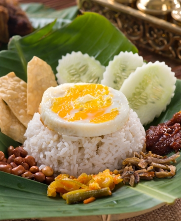 nasi lemak , malay traditional rice meal served with egg photo