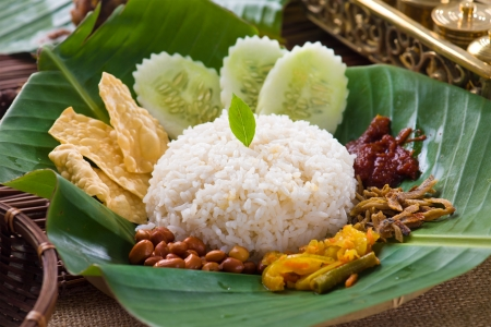 nasi lemak, a traditional malay curry paste rice dish served on a banana leaf Stock Photo - 20173104