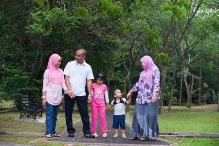 south east asian: Malay family enjoying quality time outdoor at the park Stock Photo