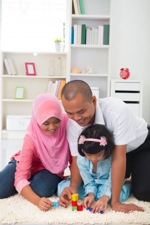 malay family learning and playing together with lifestyle background   photo