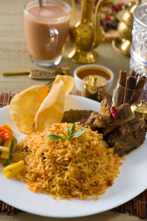 biryani: Biryani  rice with traditional items on background