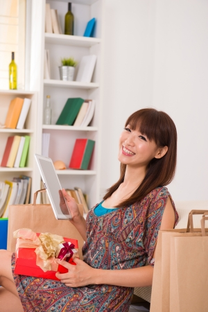 Chinese female online shopping with lifestyle background photo