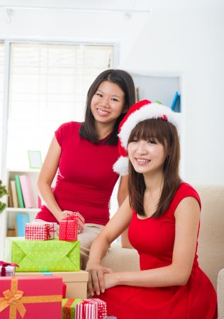 chinese friends during a christmas celebration photo