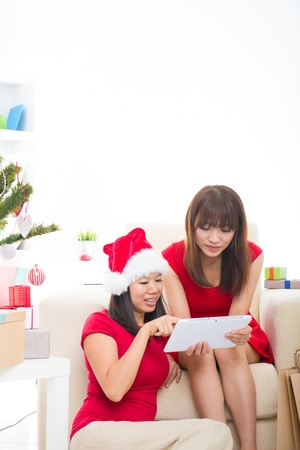 chinese girls online shopping during christmas celebration photo