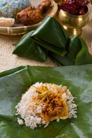 nasi: nasi lemak, a traditional malay curry paste rice dish served on a banana leaf