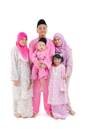 hari raya aidilfitri: malay indonesian family during hari raya occasion isolated with white background