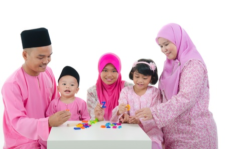 malay family playing and having quality time during hari raya   Stock Photo