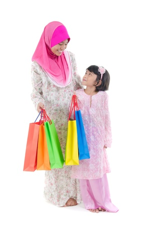 aidilfitri: Malay sisters during raya shopping festival Stock Photo