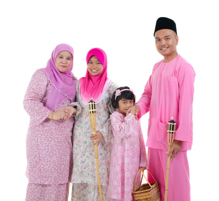 malay indonesian family during hari raya occasion isolated with white background   photo