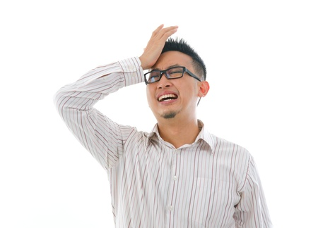 lost city: asian chinese business male having headache isolated white background   Stock Photo
