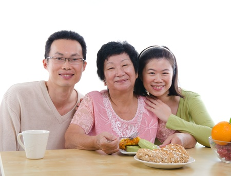 family dining: chinese family dining with isolated white background