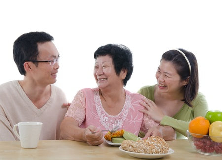 aging woman: chinese family dining with isolated white background