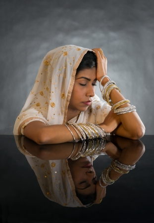Beautiful young indian woman in traditional clothing .Gorgeous brunette traditionally dressed in deep thought   photo