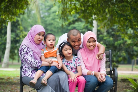 south asians: Happy Malay Asian Family enjoying family time together in the park