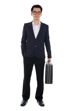 asian young business man with suitcase isolated on white background   photo