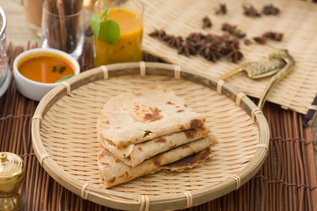 Indian flat-bread called Chapati with vegetable curry photo