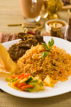 Biryani rice with traditional items on background   photo