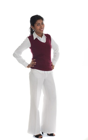 woman sweater: portrait of casual Indian woman smiling full body isolated on white Stock Photo