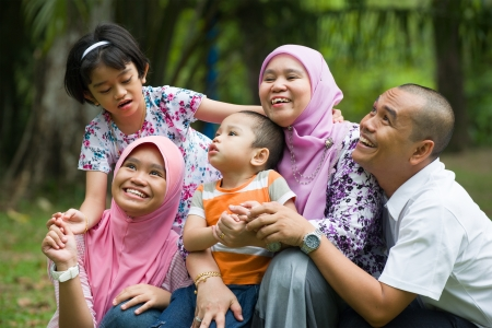 malaysian: lifestyle photo of malay family having fun in the park ,malaysian people
