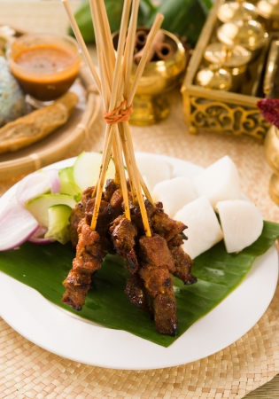 satay sauce: Satay a traditional malaysian indonesian roasted meat skewer   Stock Photo