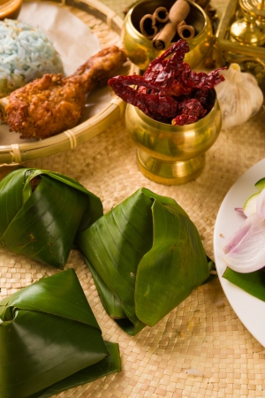 nasi: nasi lemak bungkus, a traditional malay curry paste rice dish served on a banana leaf
