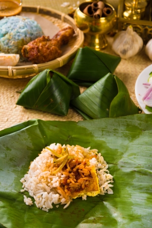 nasi lemak, a traditional malay curry paste rice dish served on a banana leaf   photo
