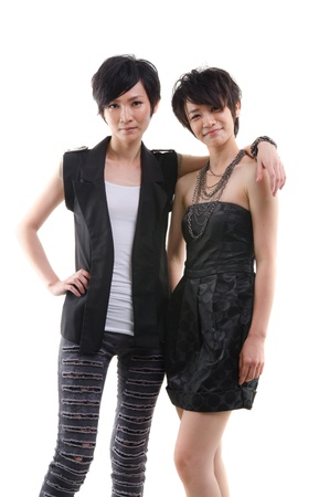 korean sisters in alternative k pop wear with isolated white background photo