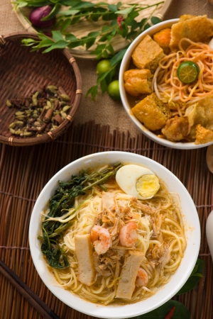 singapore famous prawn noodle or har mee with decorations on background