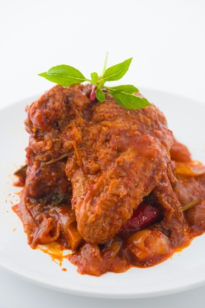 curry chicken rendang cooked in indian style with spicy sauce and chilli   photo