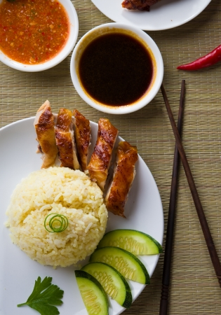 hainan chicken rice , singapore food with materials as background photo