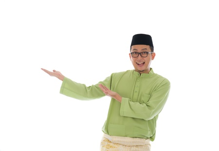 salam: Traditonal Malay man with welcome gesture during ramadan isolated white background