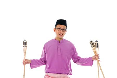 Malay man celebrating hari raya the month after ramadan photo